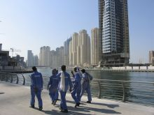 1280px-Dubai_constr_workers