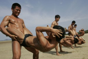 South Korean special warfare command soldiers exercise before they conduct a sea infiltration drill during a photo call in Taean
