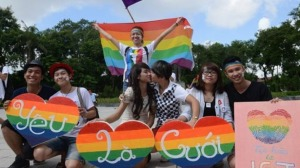 Participants-pose-for-a-photo-during-a-local-annual-gay-pride-parade-in-Hanoi-AFP