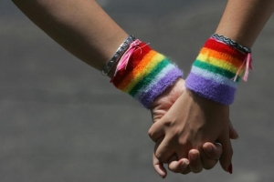 a-lesbian-couple-hold-hands-during-the-annual-gay-pride-rally-on-june-8-2007-tel-aviv-israels-most-cosmopolitan-city